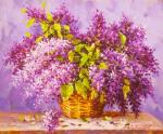 A magnificent bouquet of lilacs in a basket