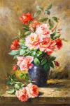 A bouquet of roses in a blue vase