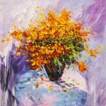 A bouquet of yellow flowers in a vase