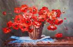 Bouquet of red poppies in a basket