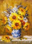 Sunflowers in a white and blue vase