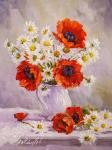 Poppies and chamomiles in a white jug