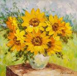 Sunflowers in a vase on the background of the garden